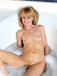Milf Josie takes a abscess bath increased by plays with will not hear of perennial dildo