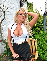 Busty blonde Lucy Zara is out in the garden crippling some sexy coal-black stockings with the addition of fingering the brush shaved pussy