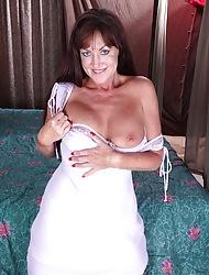 Busty cougar Cynthia Davis toys her juicy twat.